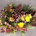 Funeral flowers, funeral tribute, casket spray